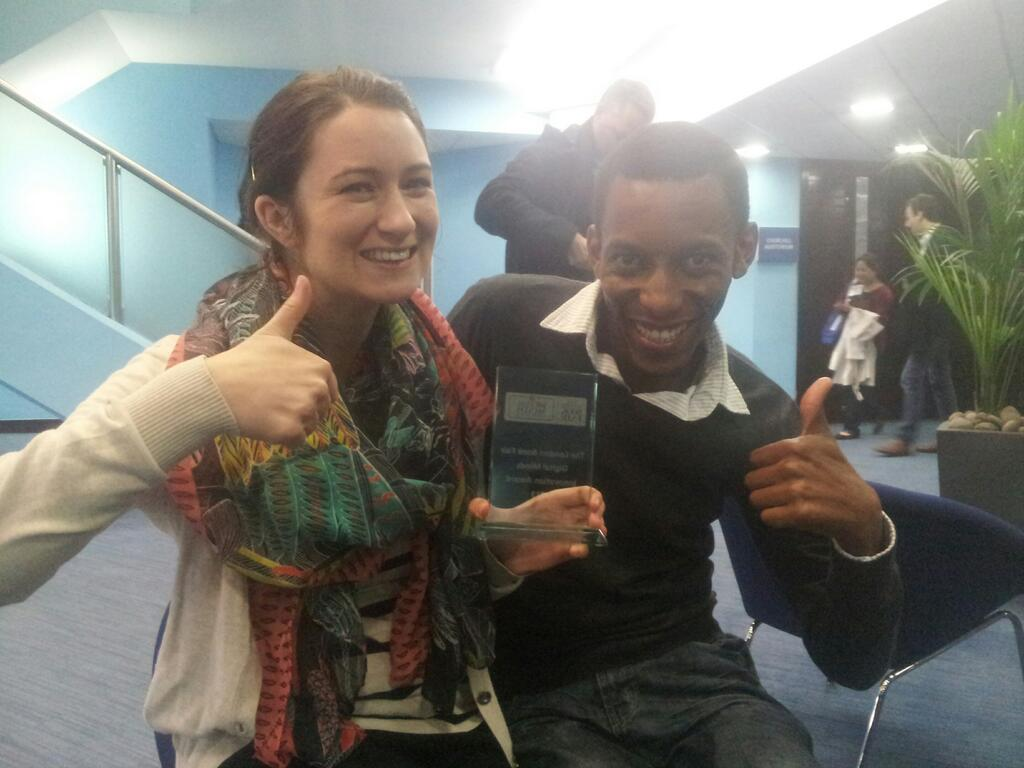 Content manager Tarryn-Anne Anderson and content curator Oscar Masinyana show off our latest piece of silverware.
